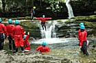 Hen party throwing themselves off a waterfall in Wales