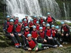 Group of teachers on activity weekend doing canyoning in the Brecon Beacons National Park, Wales, with Call of the Wild